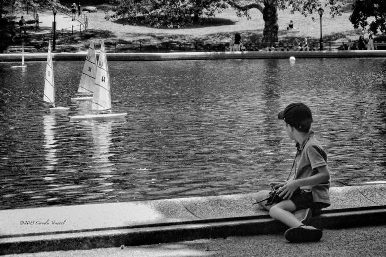 A boy and his boat at the Central Park Sailboat Pond